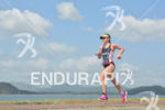 Rebeccah Wassner running at the 2014 Ironman 70.3 Panama in…