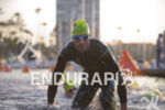 A pro triathlete exits the water at the Ironman 70.3…