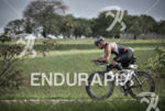 Age grouper riding among trees riding on the bike at…