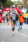 Frederik Van Lierde drinking on the run leg of the…
