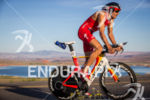 Jan Frodeno climbs on bike at the  Ironman 70.3 St.…