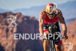 TJ Tollakson digs deep on the bike through Snow Canyon…