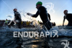 Athletes exit the water after the first lap of the…
