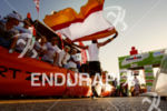 athlete at the finsih of the 2014 Ironman Lanzarote on…