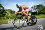 AJ Baucoo riding at the 2014 Ironman Florianopolis in Florianopolis,…