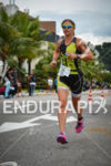 Sara Gross running for victory at the 2014 Ironman Florianopolis…