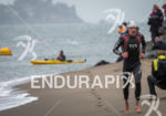 Andy Potts (USA) exits the water first and continued for…
