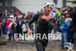 Bevan Docherty runs up beach after exiting the water at…