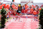 Sebastian Kienle jumps at the finish line of the 2014…