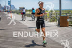 Fredrik Croneborg (SWE) runs along the boardwalk onto victory at…