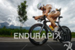 Faris Al-Sultan on the bike at the 2014 Ironman Austria…