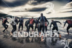 The pro men start the swim leg at Ironman Coeur…
