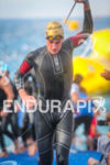 Harry Wiltshire exits the water at the 2014 Ironman France,…