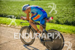 Thomas Gerlach races past the farmland at the Ironman Wisconsin…