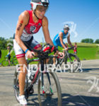 2nd place finisher Tamara Kozulina cycles past age groupers  at…