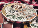 Finisher medals await their new owners at the 2014 Beijing…