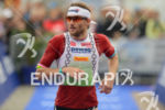 Faris Al-Sultan at the finish of the Ironman 70.3 Ruegen…