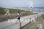 age group athlete runs out of the transition zone of…