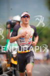 Sebastian KIENLE with his moto escort on the run course…