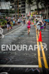 Athlete getting congratulations from spectator on the run at the…