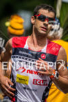 Tim O'Donnell runs through the water station at the Ironman…