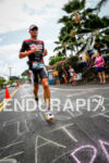 Craig Alexander (AUS) runs along Ali'i Drive during the Ironman…
