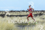 Jan Frodeno (GER) during the run portion inside the energy…