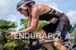 Bryan Rhodes during the bike portion of the 2014 Ironman…