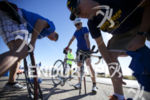 Bike support helps a cyclist with a flat tire at…