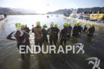 The female pros prepare to start their swim leg at…