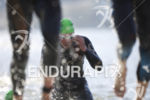 Pros exit the water at Wildflower Long Course Triathlon on…