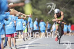 Davide Giardini passing an aid station at Wildflower Long Course…