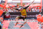 Sebastian Kienle jumps at the finish of the Ironman 70.3…