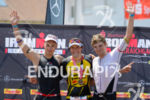 Andreas Boecherer, Sebastian Kienle, David McNamee (l-r) at the finish…