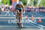 Lisa Huetthaler competes in the bike leg during the 2015…
