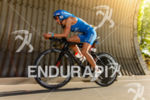Eva Wutti competes in the bike leg during the 2015…