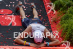 Exhausted athlete at the finish of the 2015 Ironman Austria…