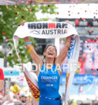 Eva Wutti celebrates at the finish of the 2015 Ironman…