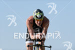 Per Bittner competes during the bike leg of Challenge Roth…