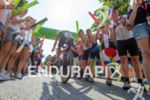 Age group athlete is cheered by spectators at Solar Hill…