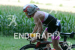 Mary Beth Ellis competes during the bike leg of the…