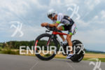 Manuel Kueng competes during the bike leg of the 2015…
