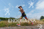 Beth Gerdes competes during the run leg of the 2015…