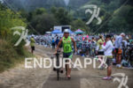 Andrew Drobeck exits T1 at the 2015 Vineman Triathlon on…