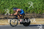 Andrew Fast bikes past the many vineyards at the 2015…