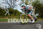 Maurice Clavel competes during the bike leg of the Ironman…
