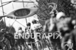 Riders make their way up the brutal Powerline climb at…