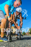 Age group athlete being helped at a mechanical aid station…