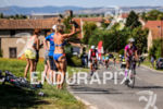 Athletes being cheered on during the bike leg of the…