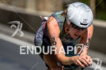 Alicia Kaye competes during the bike leg of the 2015…